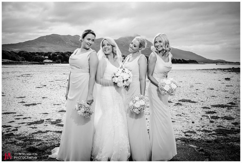 Bridesmaids witht he Reek Westport in the background
