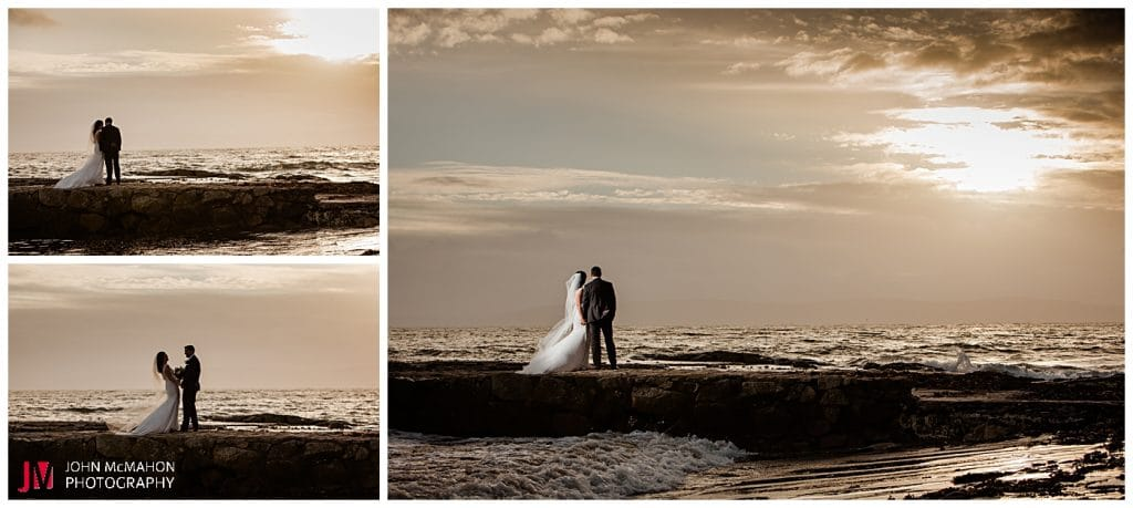 Bride and groom enjoying sunset on Galway Prom