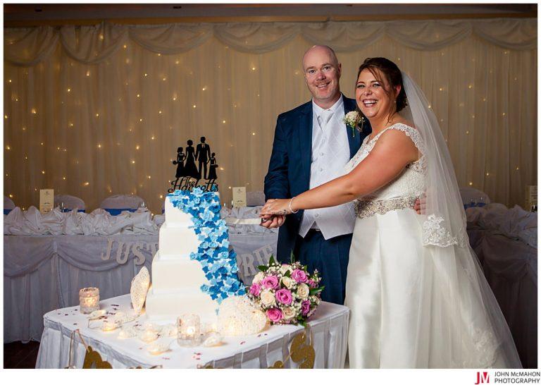 bride and groom cutting wedding cake in Clayton Hotel