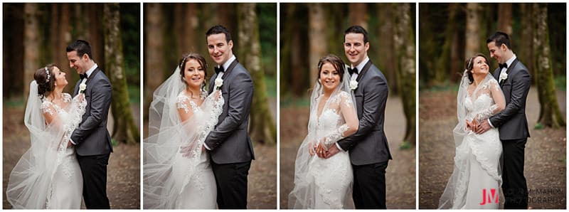 Bride and groom posing for wedding photos in Belleek Woods