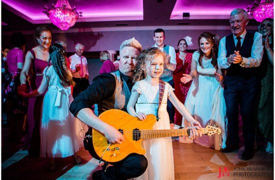 Guitarist playing guitar at wedding