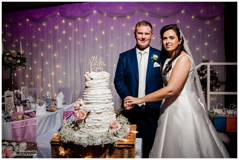 Michelle and Ciarán cutting their wedidng cake in the Broadhaven Bay Hotel Belmullett