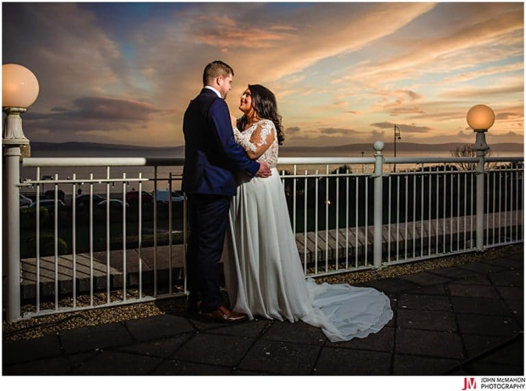 Bride and groom enjoy sunset on wedding day