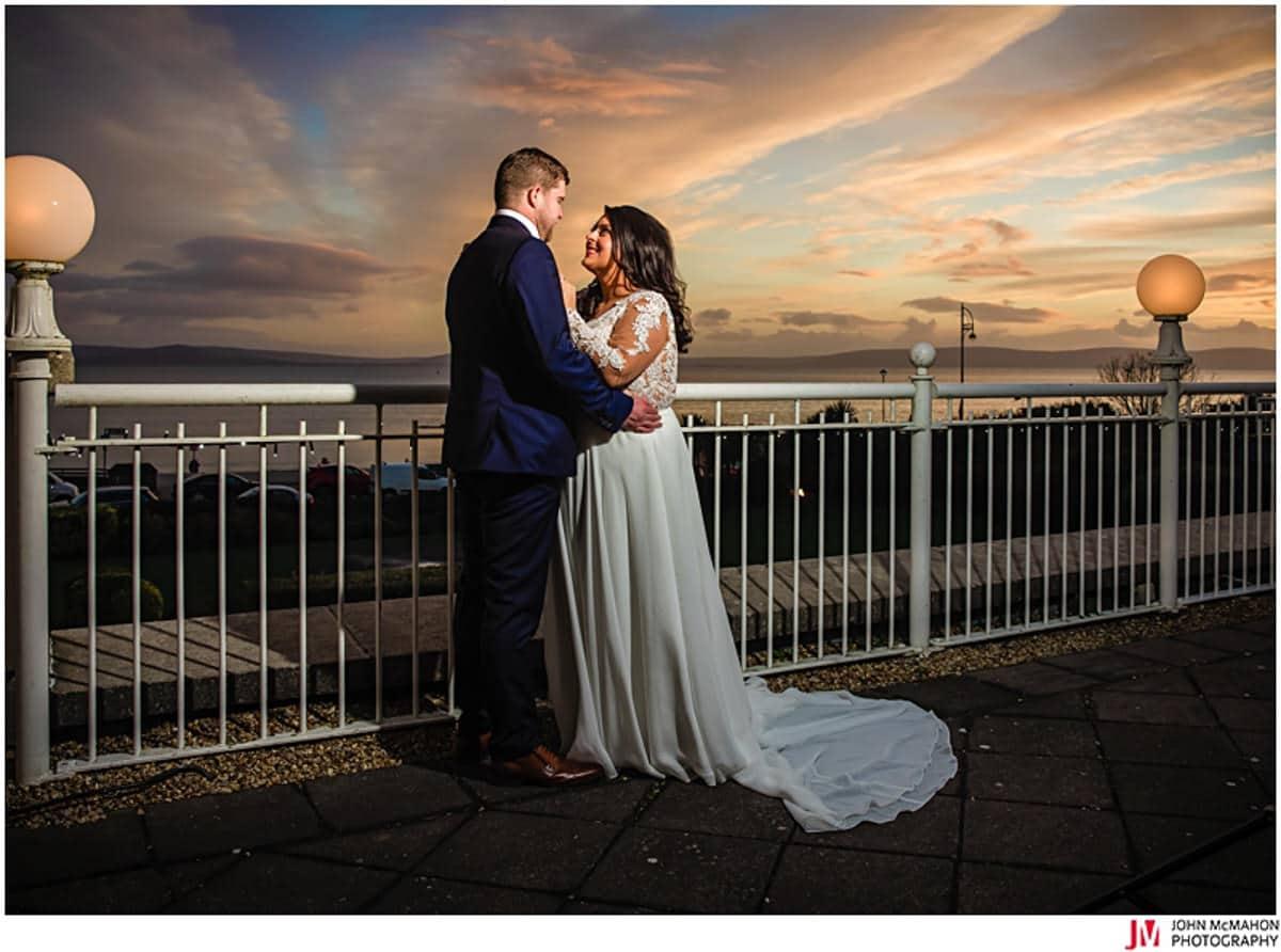 Bride and groom enjoy sunset on wedding day
