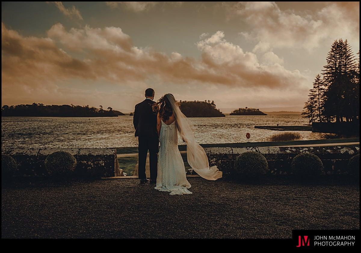 Bride and groom at dusk for Ashford Castle wedding